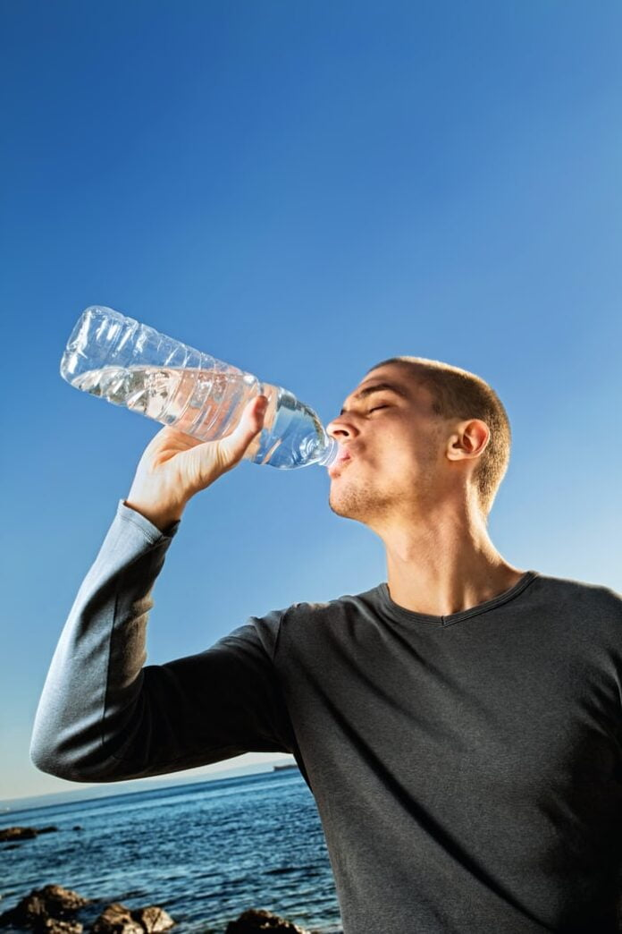 Is it good to drink water while having food?